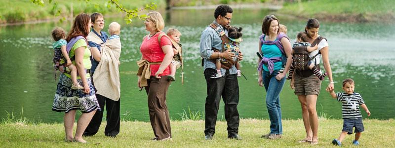 group-shot-in-front-of-lake - Babywearing International